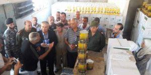 Verteilung der in Dair az-Zaur angekommenen Lebensmittel etc., Photo: SANA