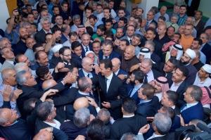 Dr. al-Assad in Qâra, Photo: SANA